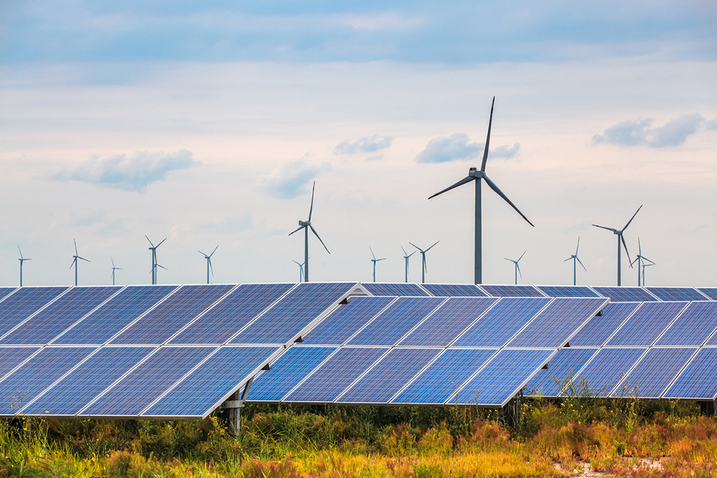 solar and wind power in coastal mud flat, renewable energy background.  Ag Producer & Agribusiness Energy Efficiency Grants farm land with wind turbines solar panel Geswein Farm and land real estate